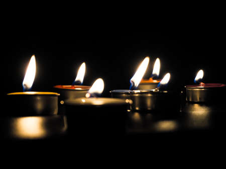 concept of mourning the dead from the corona virus represented by warm candles,COVID-19. Selective Focus Zdjęcie Seryjne