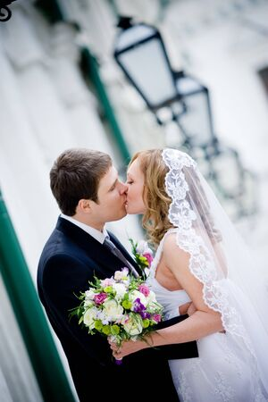 On the image there is bride and bride groom. photo