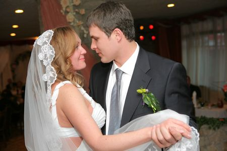 On the image there is bride and bridegroom. photo