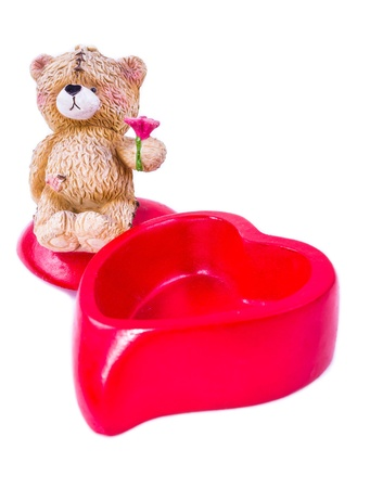 Teddy bear and heart isolated on white background photo