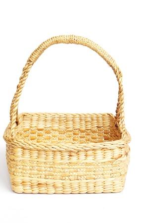 sedge basket for fruit isolated on white Stock Photo - 16053989