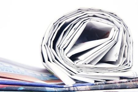 Stack of newspapers on white background photo