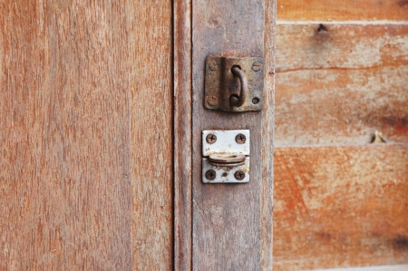hasp: old wood door and old rusty hasp               Stock Photo
