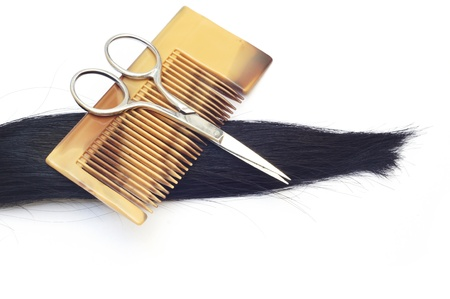 Black hair and scissors                photo