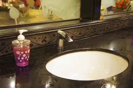 bathroom sink: washbasin in public toilet