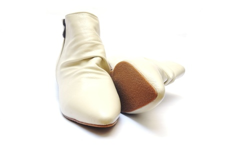 female beige boots on white background                 Stock Photo - 18652576