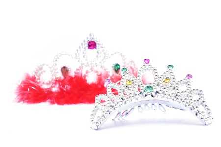 Silver crown with pink jewels on white background         photo