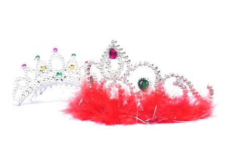 Silver fluffy crown with red jewels on white background                 photo