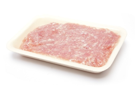 raw minced pork on styrofoam container         photo