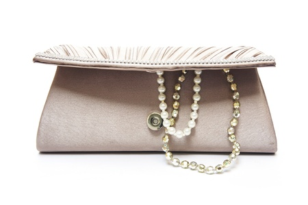 brown clutch bag with jewel on white background        photo