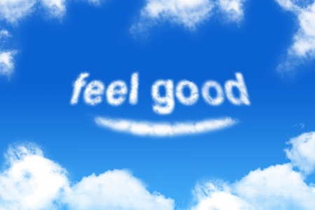 feel good - cloud word on blue sky background Archivio Fotografico