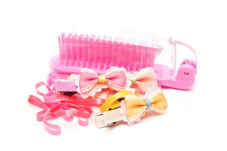 comb hair: Rosa pettine di plastica, fascia dei capelli e l'arco su bianco decorazione dei capelli bassa per la ragazza