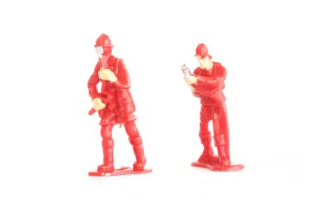 fire fighter: miniature toy fire fighter on white background Stock Photo