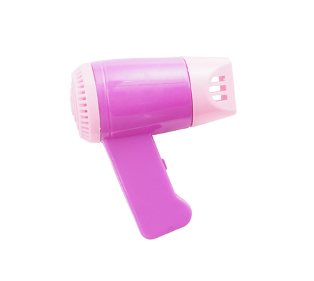 hair dryer - miniature plastic toy on white background photo