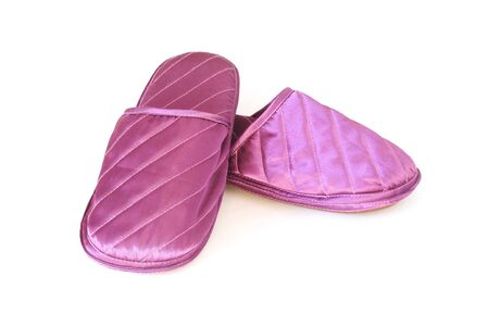 houseshoe: A pair of purple slippers on white background