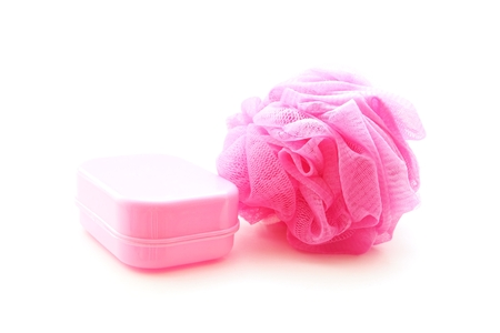 scrubber: pink soapbox and shower scrubber on white background