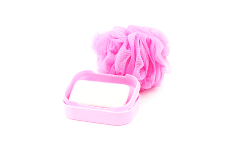 scrubber: pink soapbox with soap and shower scrubber on white background