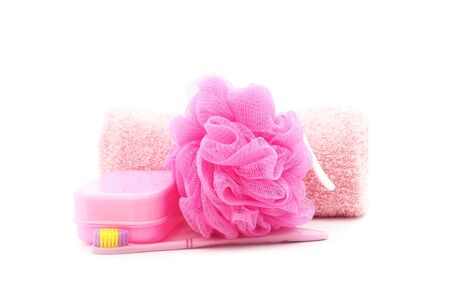 scrubber: pink toothbrush, soapbox, towel  and shower scrubber on white background Stock Photo
