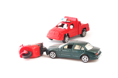 a white police motorcycle: toy car and motorcycle in accident on white background