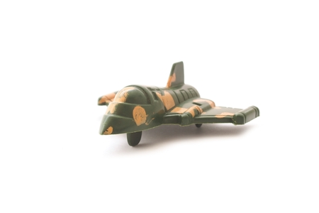 green military miniature: military miniature toy airplane on white background