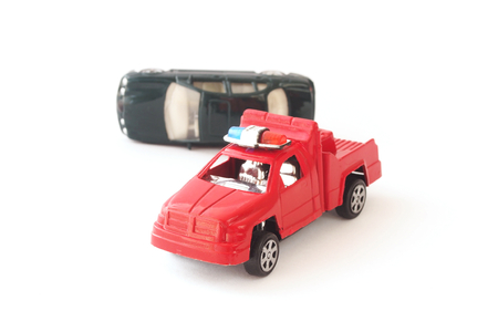 a white police motorcycle: toy cars in accident on white background