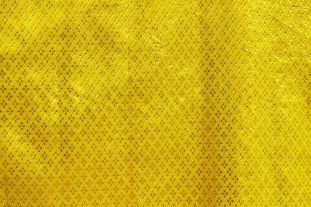 tissu or: drap d'or avec un motif traditionnel tha�landais, utile pour le fond Banque d'images