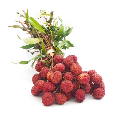 lichi: branch of ripe lychee fruit on white background