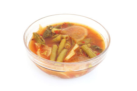 cow pea: mixed vegetable in sour soup made of tamarind paste on white background