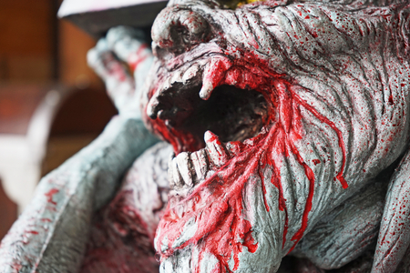 fang: fang of dead man with blood, close up