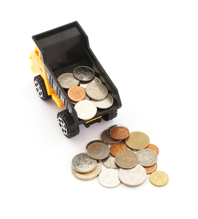 dump truck: truck dump toy and coins on white background