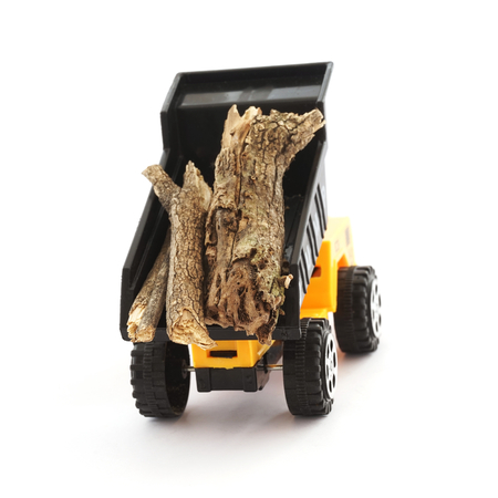 dump truck: truck dump toy and wood on white background