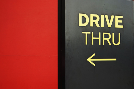 thru: yellow drive thru text with arrow