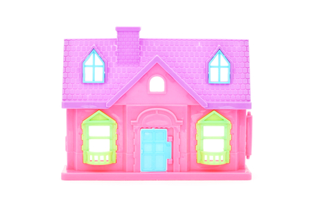 doll house: pink plastic doll house on white background