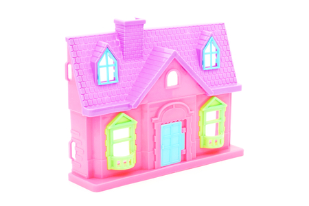 doll house: pink plastic doll house with closed door on white background
