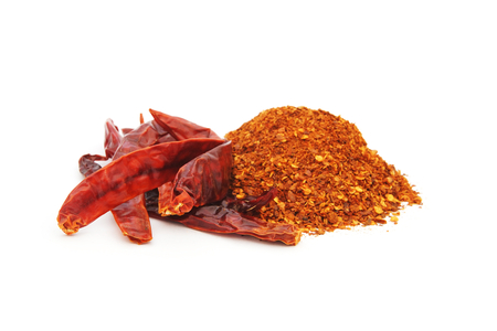 dried chili and cayenne pepper on white background Фото со стока
