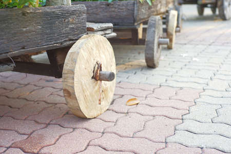 cart road: wooden wheel of cart on brick road Stock Photo