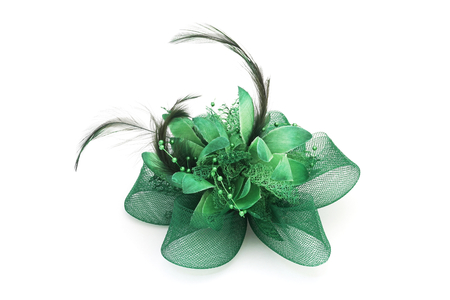 hair clip: green mesh bow hair clip with feather  on white background Stock Photo