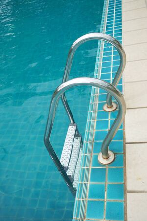 metal handrail: swimming poll handrail stairs Stock Photo