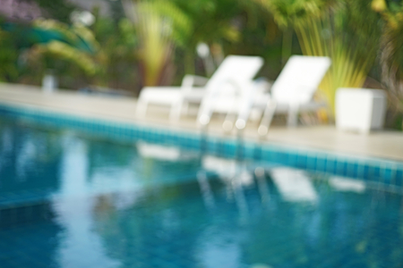 the pool: blurred swimming pool and white pool bed  useful for background