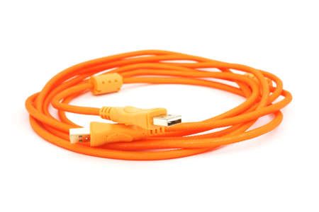 universal: Orange universal serial bus cable on white background