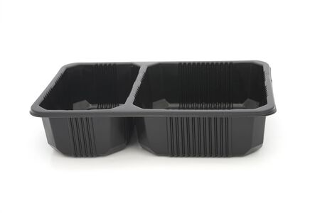 cavity: fast food black plastic tray , two cavity , on white background Stock Photo
