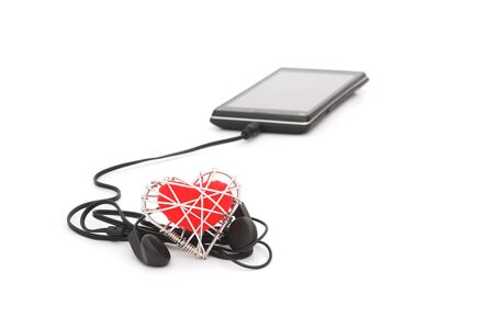 ear buds: black earphone with blurred red heart in wire mesh on white background