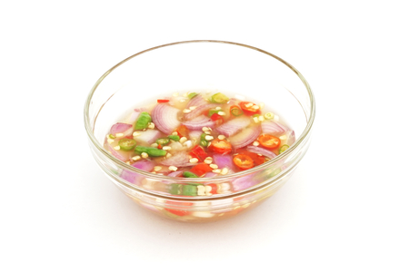 fish sauce: chili and fish sauce in glass bowl on white background
