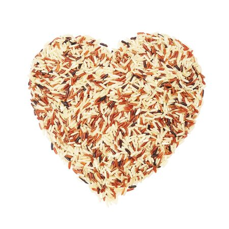 raw mixed germinated brown rice on white background , heart shape Stock Photo