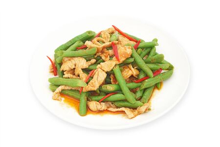long bean: stir fried pork with yard long bean  and red curry on white plate