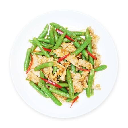 cow pea: stir fried pork with yard long bean  and red curry on white plate, top view