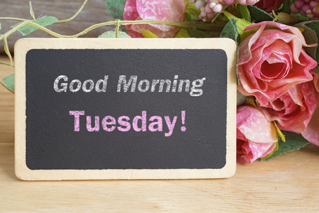 tuesday: Good Morning Tuesday word on chalkboard with roses bouquet