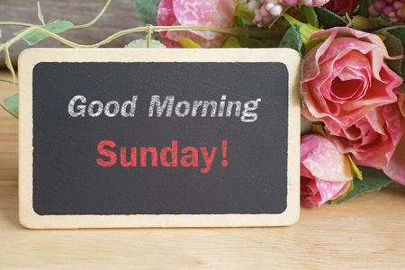 morning: Good Morning Sunday word on chalkboard with roses bouquet