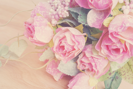 rose flower: artificial pink roses bouquet on wood, pastel tone Stock Photo