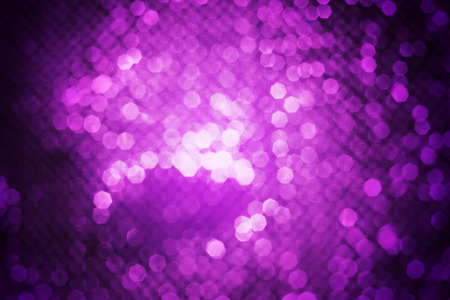 de focused: shiny purple abstract background with nature bokeh